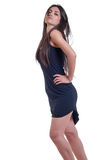 Fashion woman in a black dress isolated over white Royalty Free Stock Photos