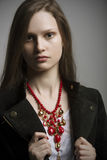 Fashion woman with black jacket and beautiful bright red color necklace Royalty Free Stock Image