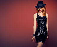 Fashion woman in black sequins dress. Party Outfit Royalty Free Stock Photo