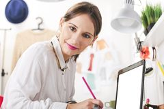 Fashion woman blogger working in a creative workspace. Young woman doing fashion sketches royalty free stock photo