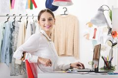 Fashion woman blogger working in a creative workspace. Young creative woman in her office looking at camera royalty free stock photography