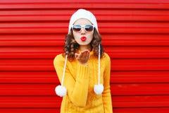 Fashion woman blowing red lips makes sends air kiss Stock Photos