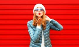 Fashion woman blowing red lips sends an air kiss on background. Fashion woman blowing red lips sends an air kiss on a background Royalty Free Stock Photos
