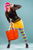 Fashion woman in bright outfit Stock Image