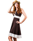 Fashion woman in brown dress and hat isolated on white Stock Photo