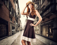 Fashion woman in brown dress and hat  on white Royalty Free Stock Photos