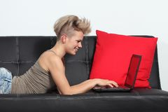 Fashion woman browsing internet in a laptop at home stock photos