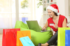 Fashion woman buying online for christmas Royalty Free Stock Photography
