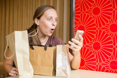 Fashion woman buying online with smart phone and credit card wit Royalty Free Stock Photos