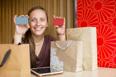 Fashion woman buying online with smart phone and credit card wit Stock Images