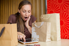 Fashion woman buying online with smart phone and credit card wit Stock Photos
