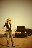 Fashion woman calling on cell phone next to broken car Royalty Free Stock Photo