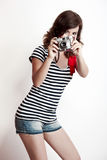 Fashion woman with a camera Stock Photos