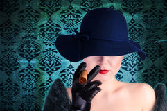 Fashion woman with cigar Royalty Free Stock Photo