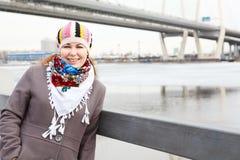 Fashion woman on city embankment Stock Image