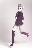 Fashion woman in coat stride Stock Photo