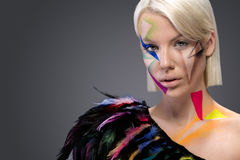 Fashion woman with colorful feathers Stock Photo