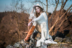 Fashion woman in country style sitting on the canyon rock Stock Photography