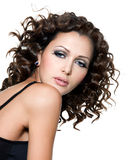 Fashion woman with curly hairs Royalty Free Stock Photography
