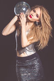 Fashion woman with disco ball Royalty Free Stock Photography