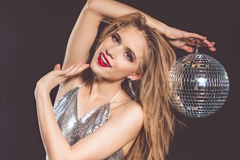 Fashion woman with disco ball isolated on black Stock Photography