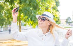 Fashion woman doing selfie. A fashion woman doing selfie royalty free stock photos