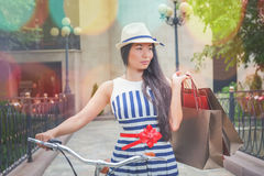 Fashion woman dressed in striped dress with bags Stock Photos