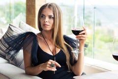 Fashion woman drinking wine in restaurant Stock Photo