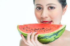 Fashion woman eating watermelon red lips, Nail Polish, yummy, ho Royalty Free Stock Photos