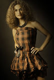 Fashion woman in elegant checked dress Stock Image