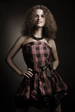 Fashion woman in elegant checked dress Royalty Free Stock Photography