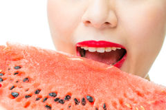 Fashion woman enjoy eating watermelon with red lips, bite Royalty Free Stock Photos