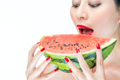 Fashion woman enjoy eating watermelon with red lips, Nail Polish Royalty Free Stock Photos