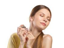 Fashion woman  enjoying  perfume Royalty Free Stock Image