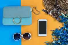 Fashion woman essentials, cosmetics, makeup accessories. Fashion woman essentials, cosmetics, cellphone, makeup accessories on colorful background, Top view Stock Images