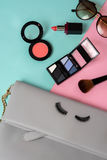 Fashion woman essentials, cosmetics, makeup accessories. Fashion woman essentials, cosmetics, cellphone, makeup accessories isolated on colorful background, Top Royalty Free Stock Photography