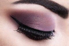Fashion woman eye makeup. Close-up macro Stock Photography