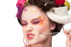 Fashion woman with face art in knitting style Stock Image