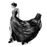 Fashion woman in fluttering dress. BW image. Isolated Royalty Free Stock Photo
