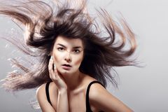 Fashion woman with flying hair Royalty Free Stock Images