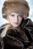 Fashion woman in fur Stock Photos