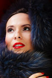 Fashion woman in fur coat, lady portrait. Fashion and beauty. Closeup woman in fur coat red lips, lady retro style portrait Stock Photography