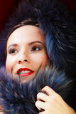 Fashion woman in fur coat, lady portrait. Fashion and beauty. Closeup woman in fur coat red lips, lady retro style portrait Royalty Free Stock Images