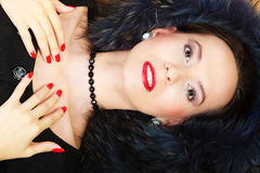 Fashion woman in fur coat, lady portrait. Fashion and beauty. Woman in fur coat red lips and nails, lady retro style portrait Royalty Free Stock Photos