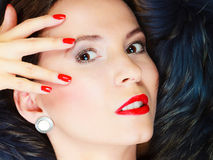 Fashion woman in fur coat, lady portrait. Fashion and beauty. Woman in fur coat red lips and nails, lady retro style portrait Royalty Free Stock Photo