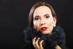 Fashion woman in fur coat, lady portrait. Fashion and beauty.  Woman in fur coat red lips and nails, lady retro style portrait on black background Stock Images