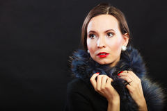 Fashion woman in fur coat, lady portrait. Fashion and beauty. Woman in fur coat red lips and nails, lady retro style portrait on black background Stock Photos
