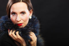 Fashion woman in fur coat, lady portrait. Fashion and beauty.  Woman in fur coat red lips and nails, lady retro style portrait on black background Royalty Free Stock Photos