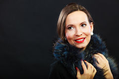 Fashion woman in fur coat, lady portrait. Fashion and beauty. Woman in fur coat red lips and nails, lady retro style portrait on black background Stock Photo