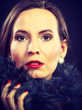 Fashion woman in fur coat, lady portrait. Fashion and beauty.  Woman in fur coat red lips and nails, lady retro style portrait on black background Stock Image